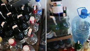Otel odasında sahte içki üretirken suçüstü yakalandılar!